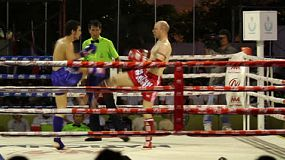 Two foreign Muay Thai kick boxers exchange blows during a fight in Bangkok, Thailand.