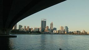 View of the City of Perth from under the Narrows Bridge, with the bridge framing the shot.