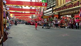 People line the streets and wait patiently for the Chinese New Year parade to start.
