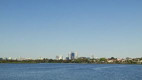 Wide angle view of the Swan River with the Perth City skyline.