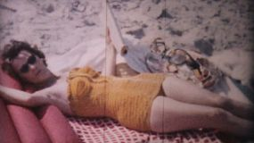 A pretty woman enjoys sunbathing on the beach in Ocean City, New Jersey while on her honeymoon in 1958.