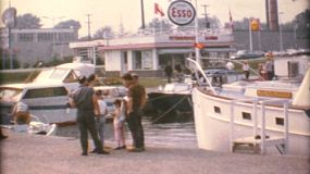 A yacht is moored on the pier waiting to get gas before setting sail on a new voyage in the summer of 1967.