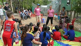 A group of young adults on a short-term overseas mission trip teach oral hygiene to Khmer children living in the slums of Cambodia.