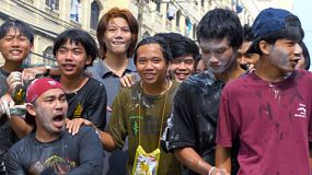 Bangkok, Thailand - April 14, 2014: A group of young Thai men fooling around for the camera, as the are soaked and covered in talcum powder while enjoying the water fights of the annual Songkran Festival in Thailand.
