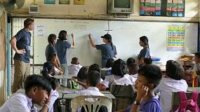 A group of young adults on a short term overseas missions trip have fun teaching English to Thai children in Ratchaburi, Thailand.