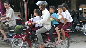 Cambodian Family Going To School On A Motorcycle