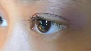 Eyes Of Little Asian Girl On Computer - Close Up