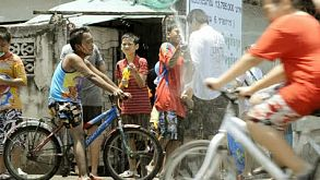 Songkran Water Fight With Passing Motorbikes And Bicycles